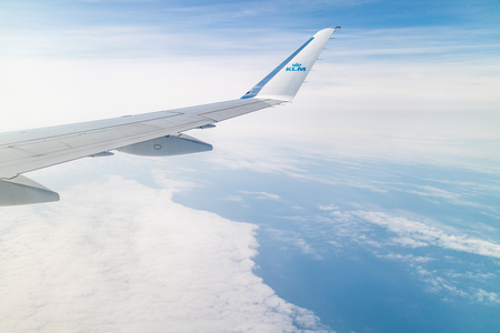 Amsterdam, The Netherlands - 08/15/2018: The view out of the window of a KLM flight into Amsterdam