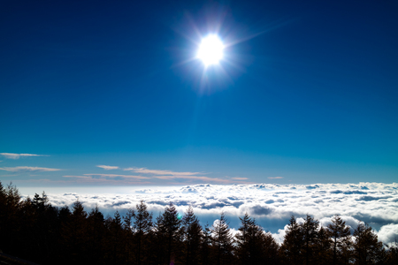 An expanse of clouds with the sun above them, taken from Mt. Fuji, Japan