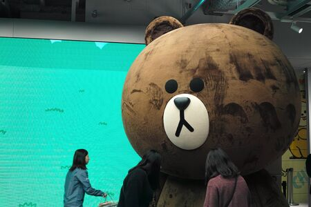Tokyo, Japan - 11/19/2018: A giant Cony Bear, the brown bear mascot for the Korean messaging App Line. From the Line store in Tokyo, Japan Archivio Fotografico - 132422205