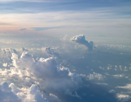A cloud shaped like an elephant in clear blue skies