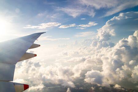 Blue skies and sun, as seen through an aircraft window in flight Reklamní fotografie