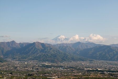 A row of mountains and the peak of MT. Fuji, taken in Yamanashi prefecture