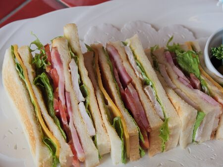 A delicious looking club sandwich on a white plate with a top down view Archivio Fotografico - 133451901