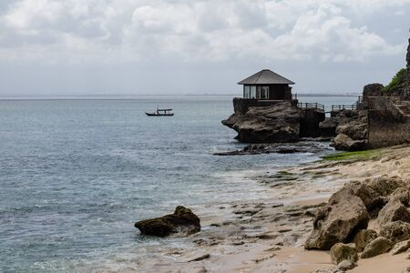 beautiful coastal scenery with a wooden hut perched out at sea Archivio Fotografico - 133812181