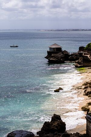 beautiful coastal scenery with a wooden hut perched out at sea Archivio Fotografico - 134651254