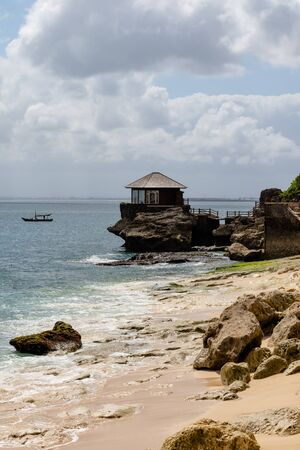 beautiful coastal scenery with a wooden hut perched out at sea Archivio Fotografico - 134651271
