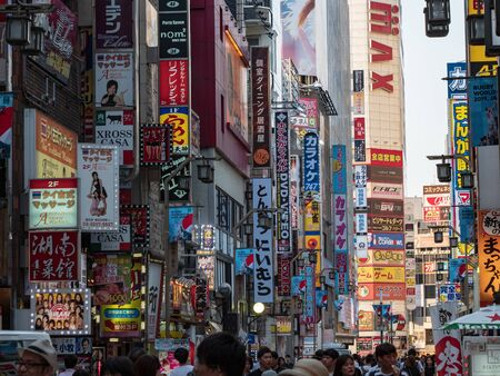 Shinjuku, Japan - 30 8 19: The signs of Kabukicho during the day, before the neon signs are turned on