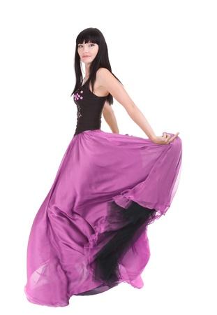 long shots: Bella donna asiatica twirling nel suo vestito alla moda colore viola Archivio Fotografico