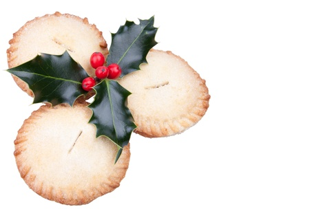 Traditional christmas mince pies with holly isolated on white