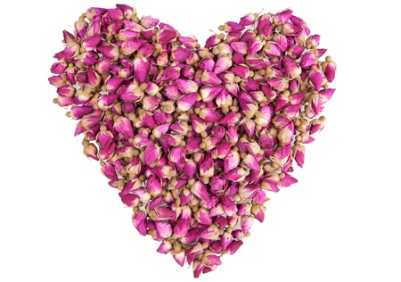 heard: Shape of a heart made out of dried pink roses isolated on white