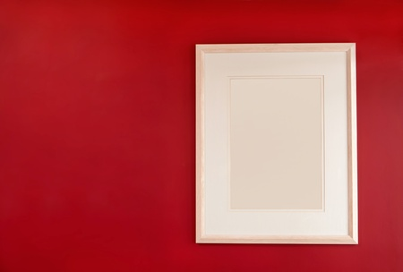 Picture frame on  red wall photo