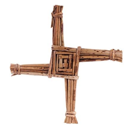 St. Brigid das Kreuz aus Stroh isoliert auf weiß. 1. Februar ist St. Brigid Festtag. Brigid Cross segnete das Haus und geschützt vor Feuer und Böse.