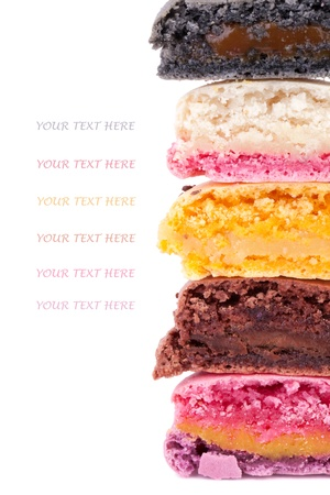 Cut into half of colorful macaroons to show delicious fillings   Copy space for your text photo