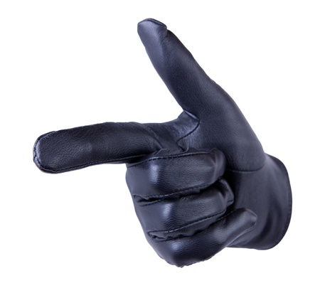 Pointing or shooting hand in black leather glove  isolated on white background photo