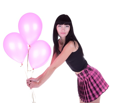 Beautiful brunette woman holding pink balloons photo