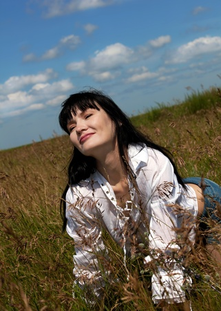 A beautiful brunette woman relaxing and having  fun in the field photo
