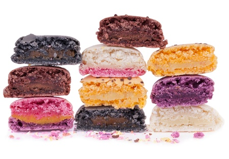 Half cut  colorful macaroons showing their delicious fillings photo