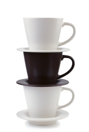 Three plates and coffee cups stacked together on white background Stock Photo
