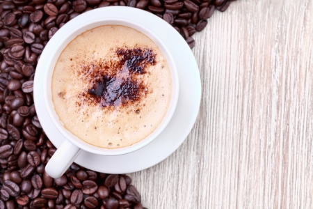 Coffee cup  with roasted coffee beans on wooden surface Stock Photo - 15564630