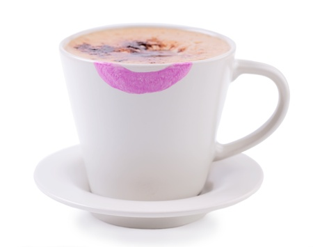 Coffee cup with lipstick print on white background Stock Photo - 15564175