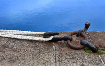 Rope for mooring a sailboat to a pier   Stock Photo