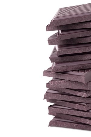 Stack of dark chocolate isolated on white photo