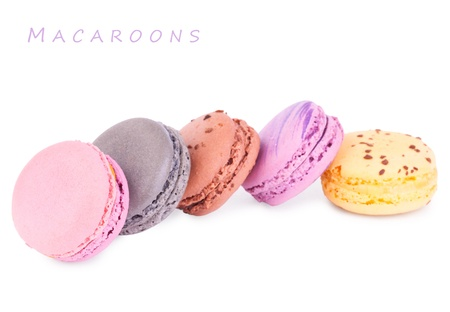 Colorful fresh delicious macaroons isolated on white. Copy space for your text photo