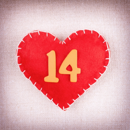 number 14: Concept for Valentines day, red heart with wooden numbers 14  on vintage fabric background