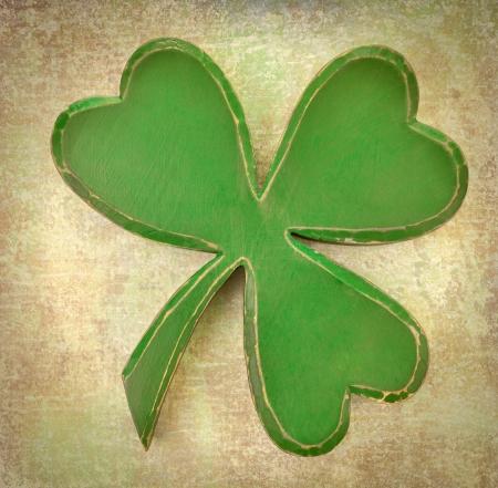 saint paddy's: Green shamrock on vintage texture Stock Photo