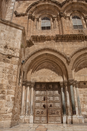 Main entrance to the Church of the Holy Sepulchre in old city of Jerusalem photo