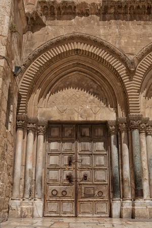 church of the holy sepulchre: Close up of main entrance to the Church of the Holy Sepulchre in old city of Jerusalem
