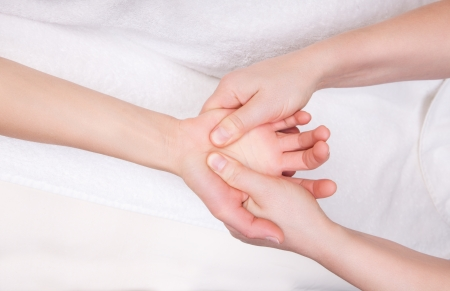 Qualified therapist doing therapeutic palm massage Stock Photo - 19892415