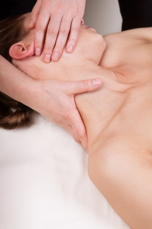 A woman getting relaxing massage on trapezius muscles of the neck by a qualified therapist Stock Photo - 20048272
