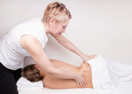 sciatic nerve: A qualified therapist doing pressure point massage to release sciatic nerve pain Stock Photo