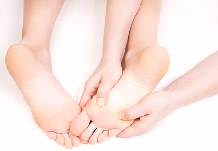 Therapist doing a foot massage,  pressing reflexology zones  Stock Photo - 20241823