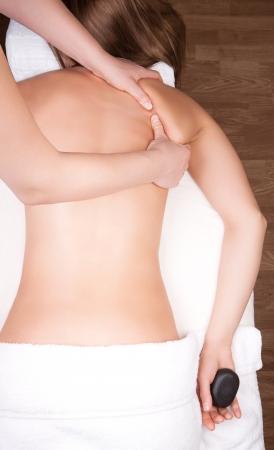 Therapist doing  massage around shoulder blade
