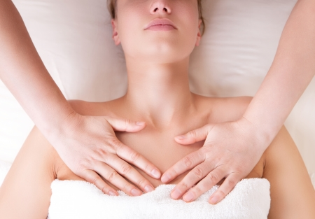 pectorals: Therapist doing massage releasing tension by pressing chest on pectoralis major muscle Stock Photo