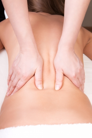 Deep tissue massage on the woman photo