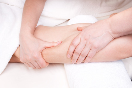 Therapist doing anti cellulite massage to improve skin condition photo