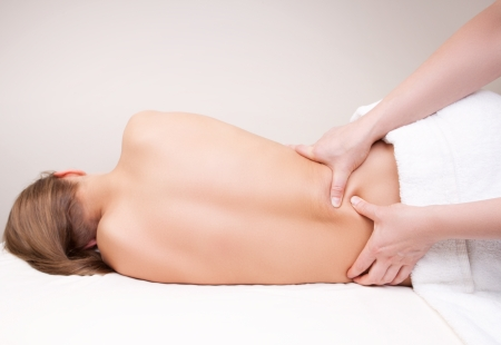 massage hands: Deep tissue massage on the womans lower back on quadratus lumborum muscle