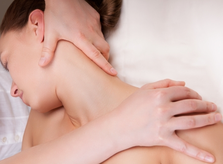 Therapist doing massage on a woman photo
