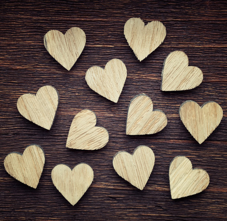 Twelve wooden hearts placed nicely on a vintage wood background Stock Photo