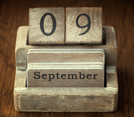 september 9th: A very old wooden vintage calendar showing the date 9th September on wood background