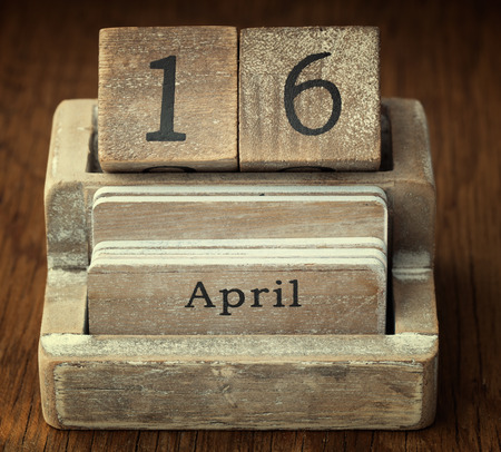 sixteen year old: A very old wooden vintage calendar showing the date 16th April on wood background
