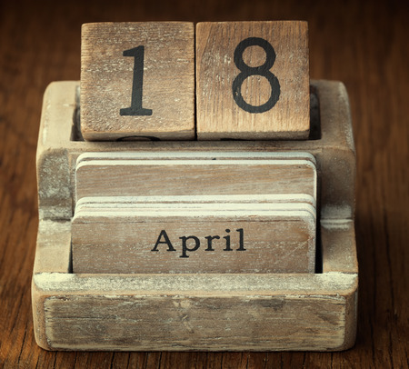18 month old: A very old wooden vintage calendar showing the date 18th April on wood background