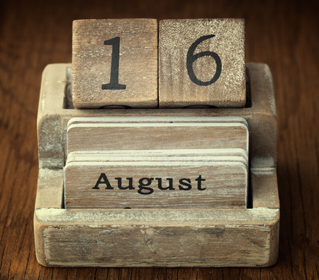 sixteen year old: A very old wooden vintage calendar showing the date 16th August on wood background