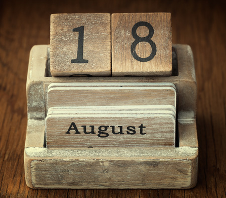 18 month old: A very old wooden vintage calendar showing the date 18th August on wood background