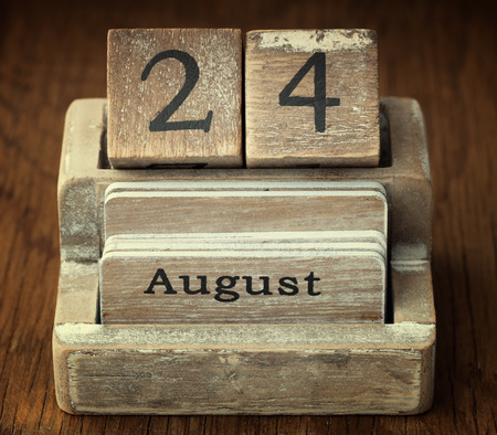 24 month old: A very old wooden vintage calendar showing the date 24th August on wood background