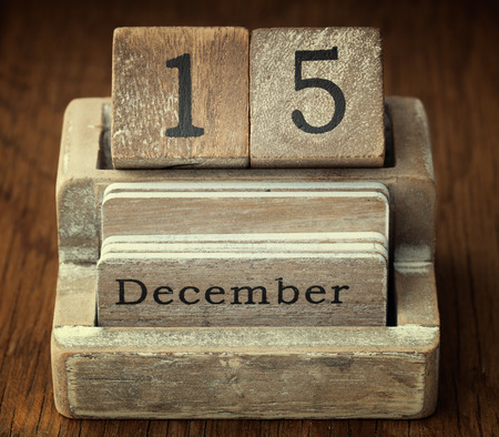fifteen year old: A very old wooden vintage calendar showing the date of 15th December on wood background