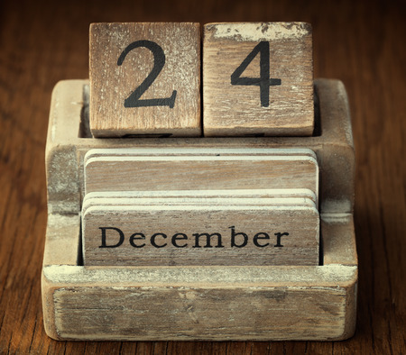 twenty four month old: A very old wooden vintage calendar showing the date of 24th December on wood background Stock Photo